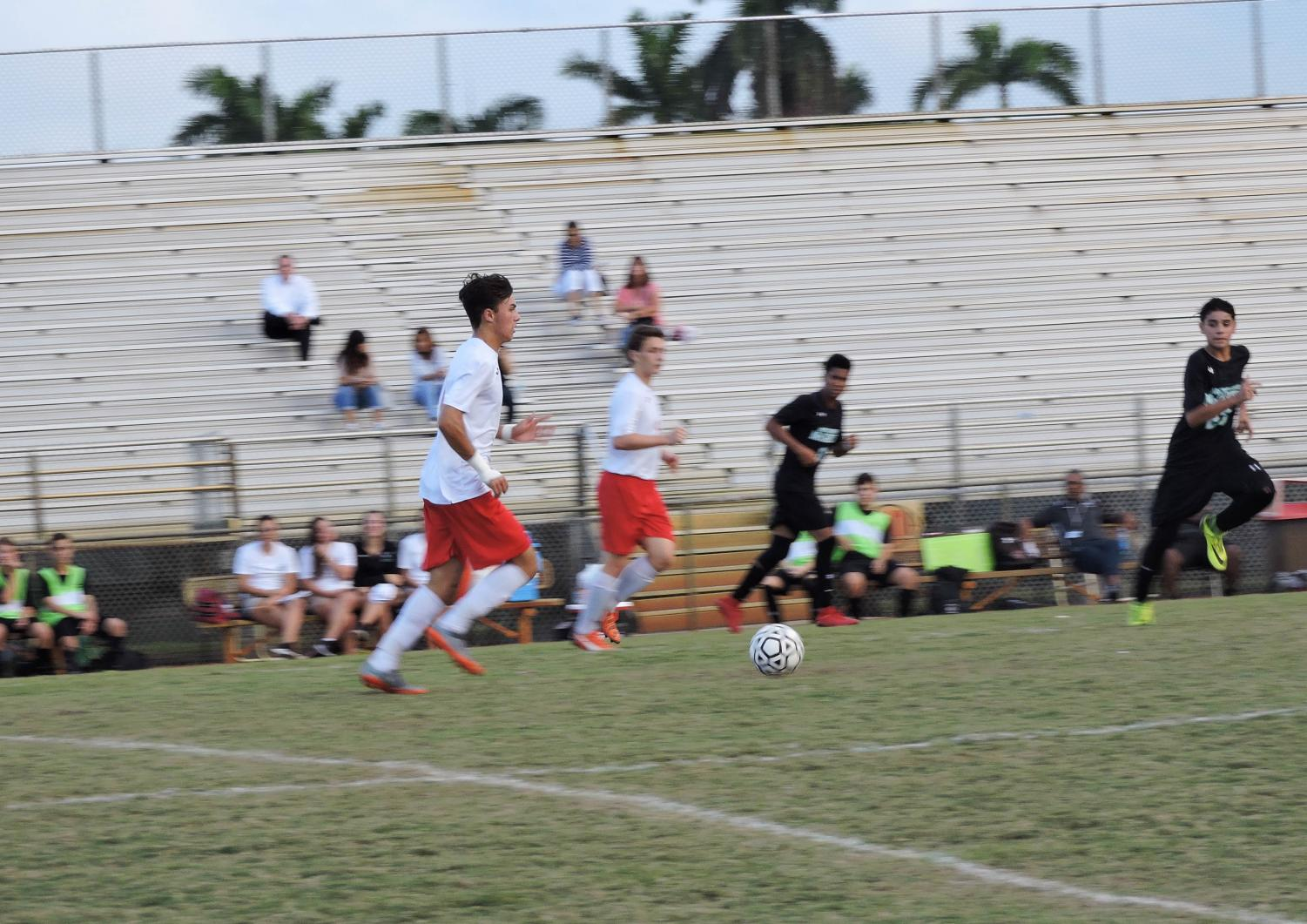 Damian Fernandez dribbles against the Archbishop defense in the final minutes of the first half. (4-1 Win against Archbishop McCarthy)