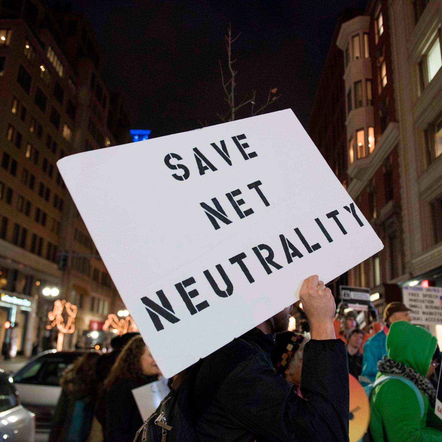 Protester advocating for Net Neutrality to stay in place.