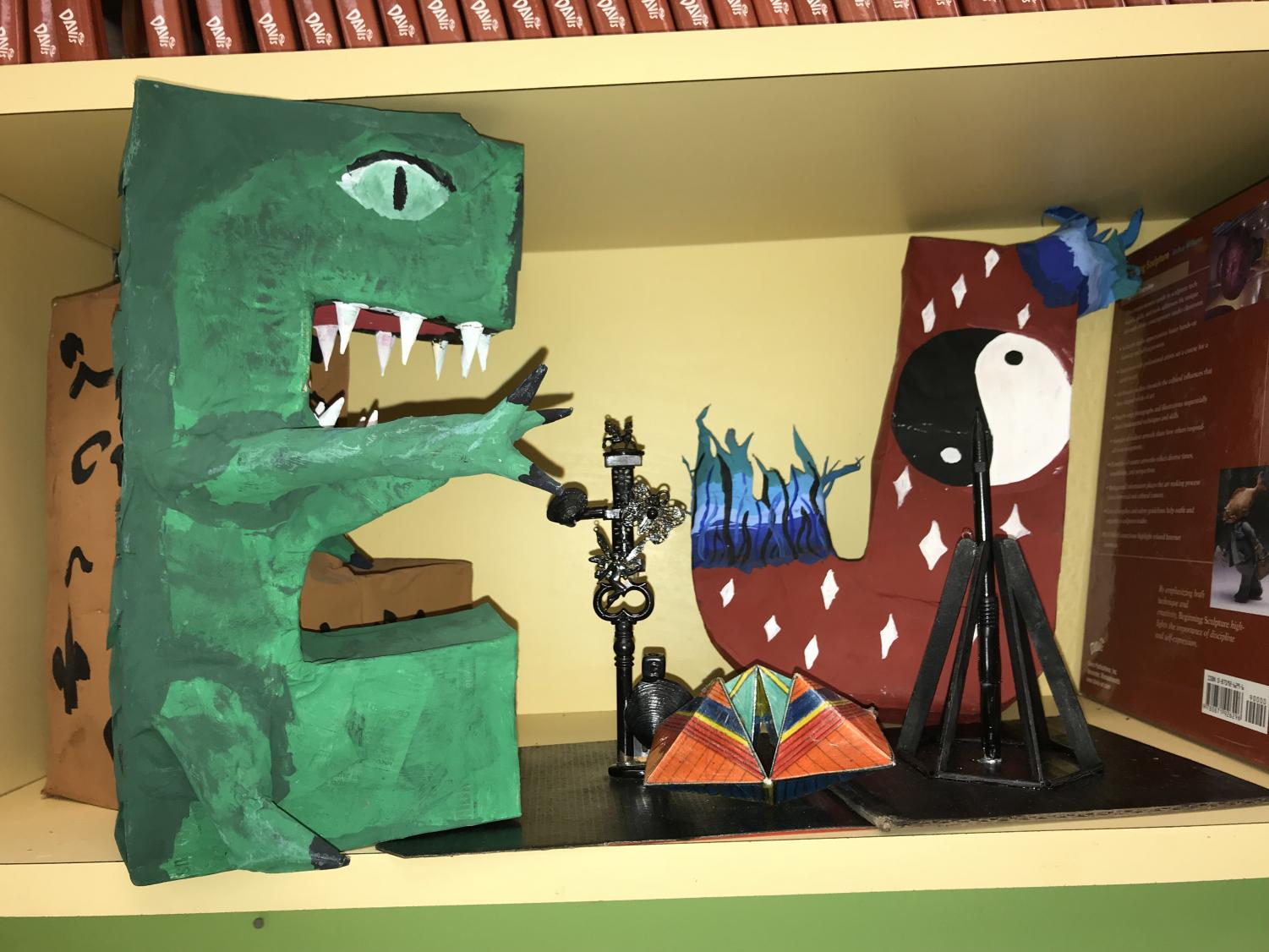The+shelves+are+covered+by+giant+paper+mache+letters.+Each+letter+is+hand+painted+and+shaped+by+students.+Completed+art+projects+are+always+shown+off+within+and+outside+of+the+art+room.+