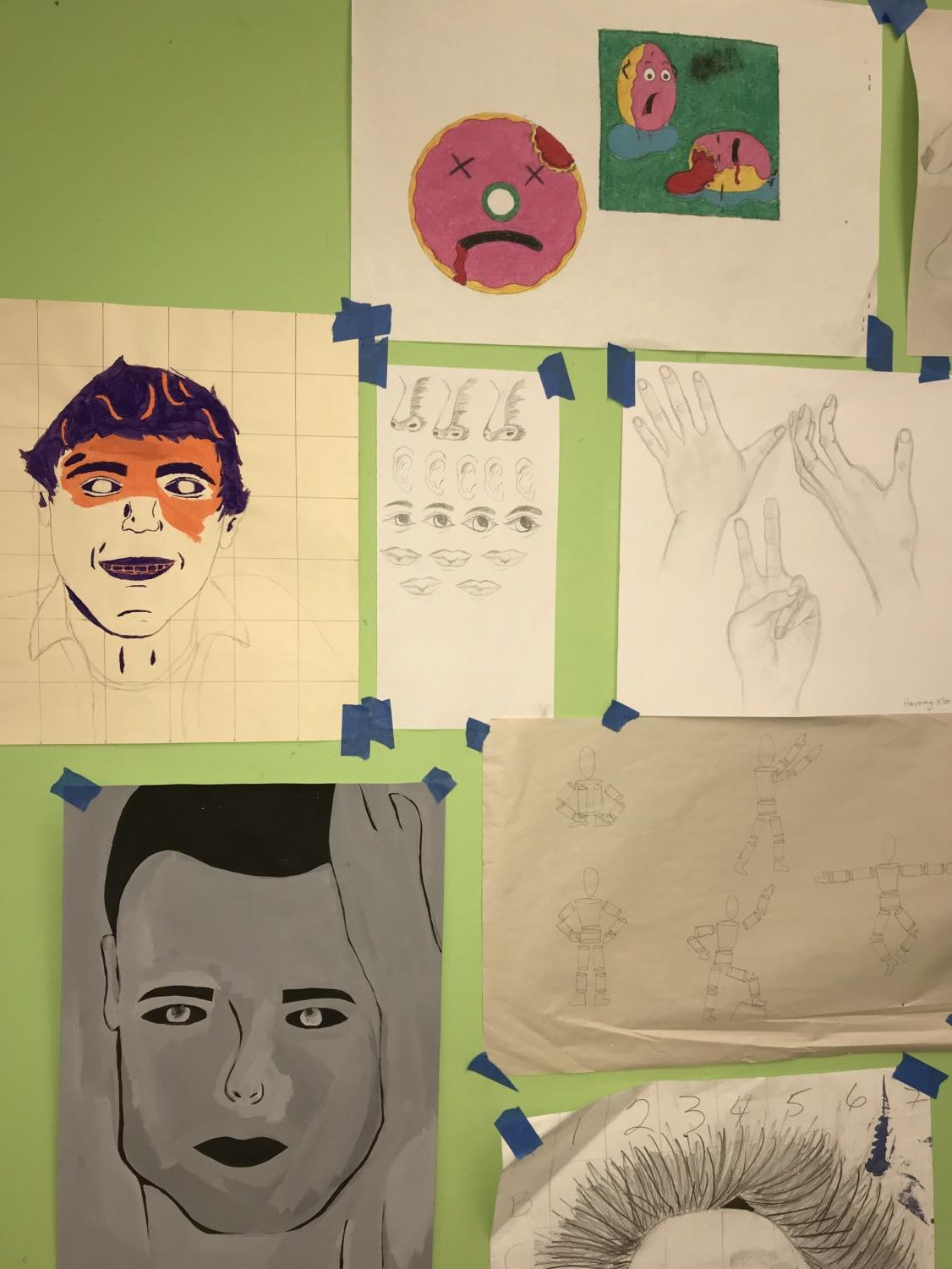 Self+portraits+and+other+diverse+designs+are+scattered+all+over+the+walls+of+Ms.+Shapiro%27s+room.+Not+only+does+the+Sculpture+program+focus+on+creating+three+dimensional+art%2C+students+are+also+encouraged+to+display+their+individuality+through+drawings.+The+principles+of+deign+and+elements+of+art+are+taught+by+Ms.+Shapiro+as+well.+