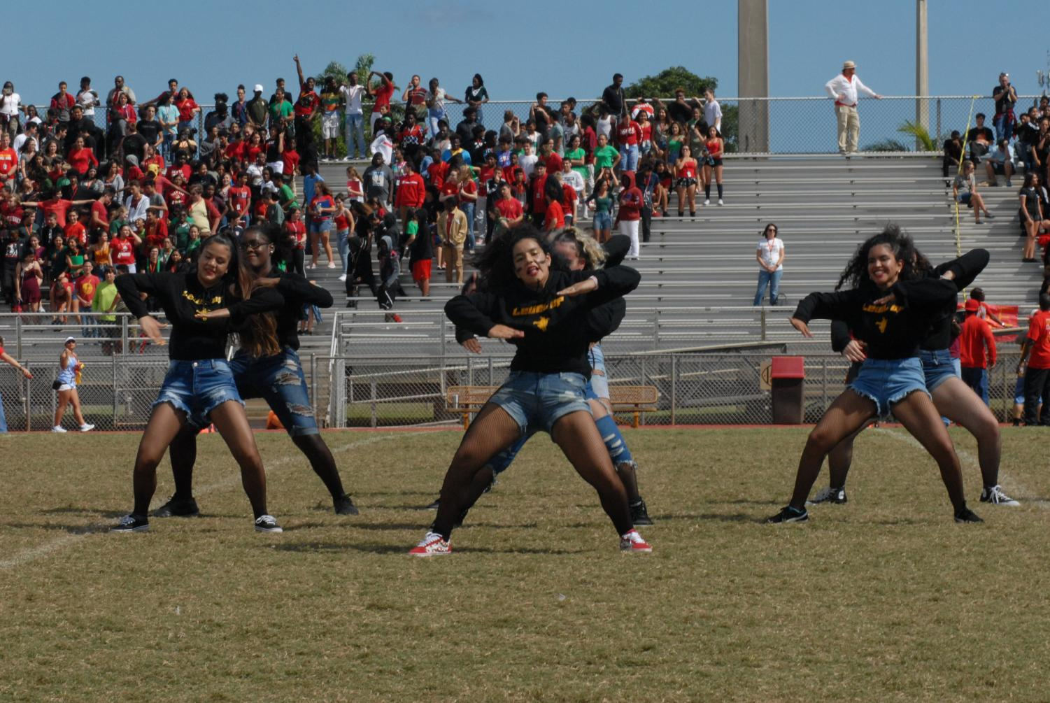 The dance team getting the crowd hyped with their dance moves .