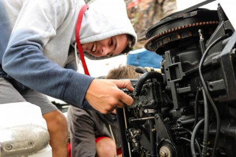Terence Addrison works on fixing a problem with a motor.
