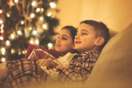Happy children watching Christmas movies