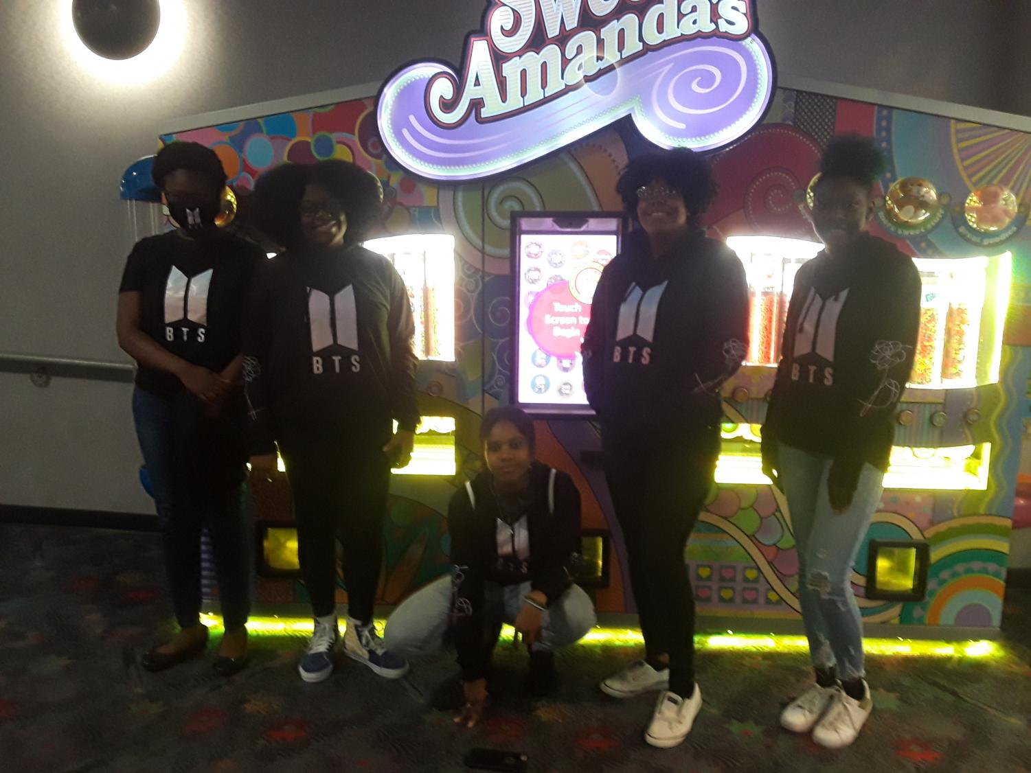 Five fans sport their hoodies at Oakwood 18.  On January 26, fans swarmed the theatre, anxiously awaiting for the premier of