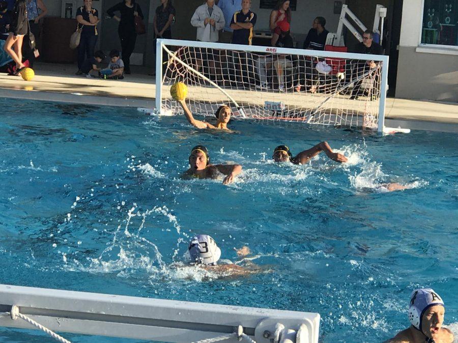 Sophomore+Logan+Green+defends+the+goal.