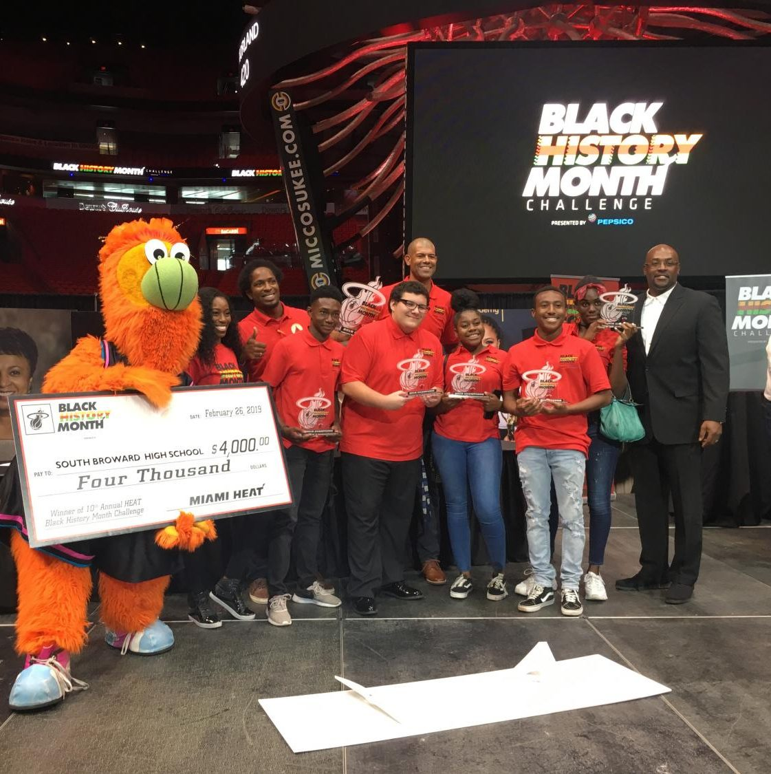 South Broward accepts $4000 check from the Miami Heat