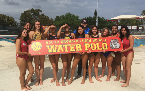 The Girl's Water Polo team poses with Coach Mark Veszi for a team photo before practice at the SBHS pool on March 18th.