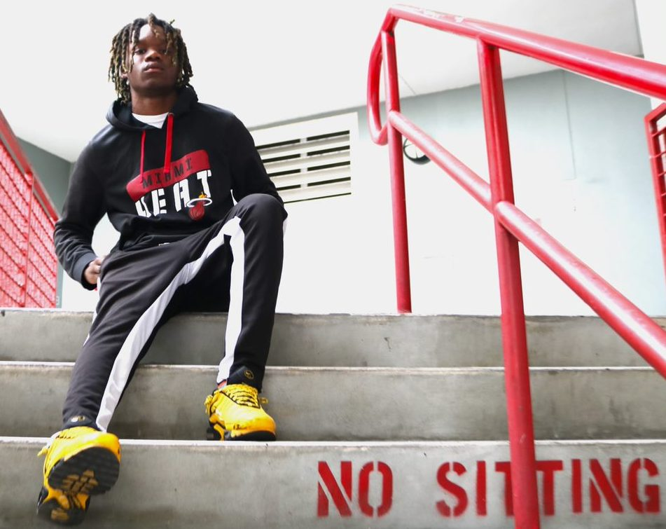 Rapper Frank Williams sitting on the steps of the 700 building.