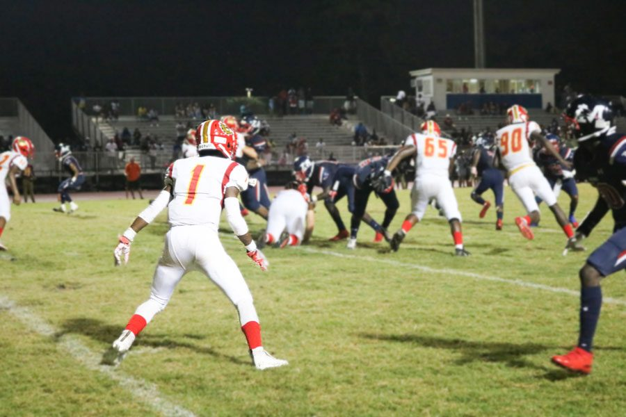 Jamil+Nelson+steps+out+to+attack+his+opponents+and+try+to+score+against+the+Patriots.+South+Broward+lost+to+Miramar+High+School+in+a+2-27+game.+