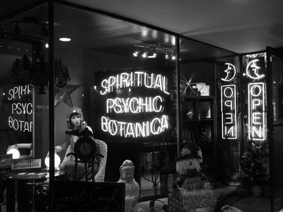 The+Spiritual+Psychic+sign+brightens+the+sidewalk.+This+psychic+has+been+open+since+1984+and+still+gives+readings+to+this+day.