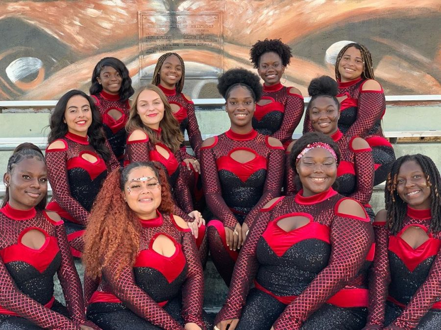 SBHS+Color+Guard+team+poses+with+their+black+and+red+sequin+costumes.+
