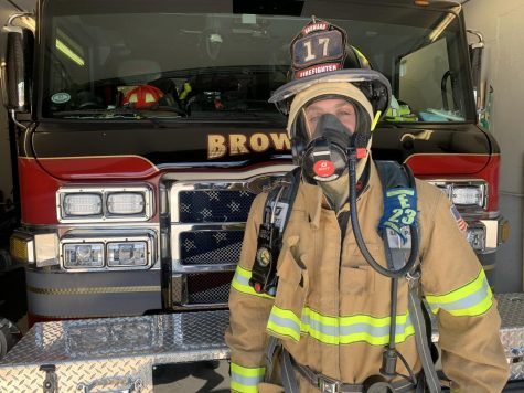 What a firefighter wears when responding to a call during the coronavirus pandemic