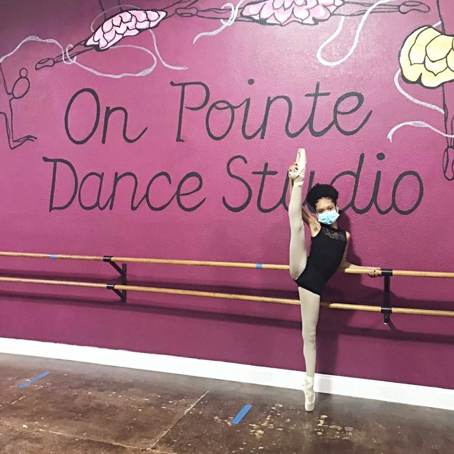 Francheska Freeds warms up for her next ballet class. She wants to prepare for the demanding lesson while en pointe.