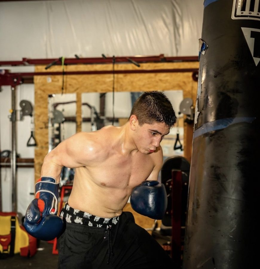 Jonathan Blanco, 19, trains with a punching hung up in a warehouse he frequents to prepare for his debut boxing match in December 2020.