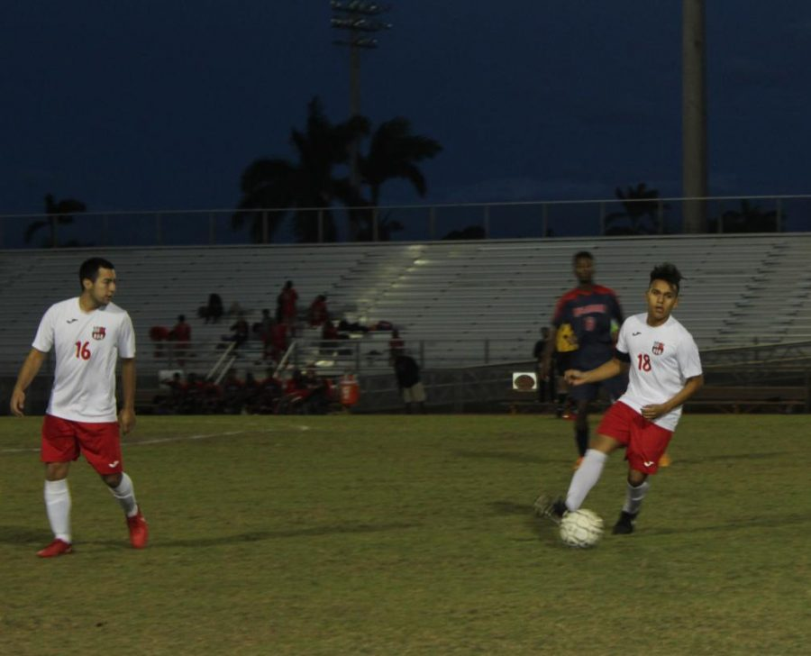 Eduardo dribbling past an opponent making his way to a goal .