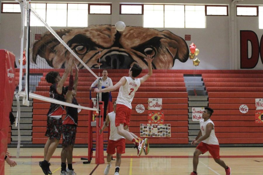 Justin Whitehead spiking the ball