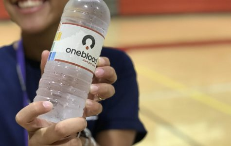 Daniela Garcia of the HOSA Club quenching her thirst after hard work volunteering for the blood drive.