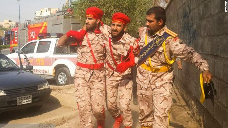 Iranian soldiers limping away after getting wounded and shot by terrorists that attacked on October 4,2018.