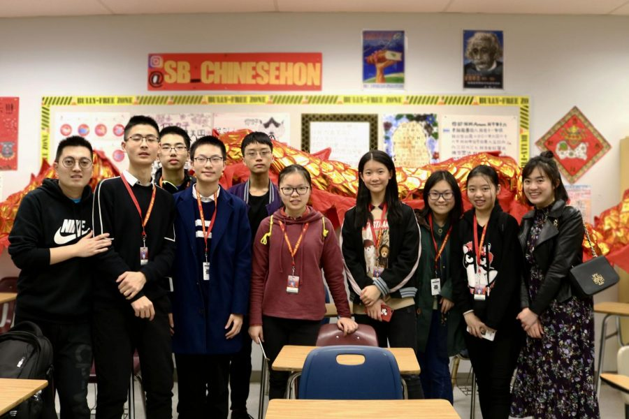 Eight+students+and+two+chaperones+which+traveled+from+China+on+a+school+trip+to+learn+about+America+and+how+our+country+is.