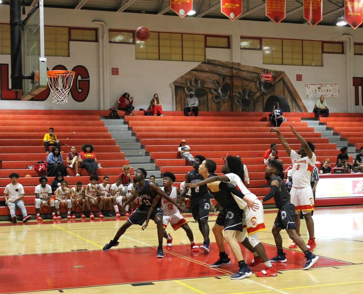 Issac Tewolde takes, and ultimately makes, a two-point shot during the last home game for SBHS Boys Varsity Basketball. The Bulldogs beat Taravella, nearly 55-54.