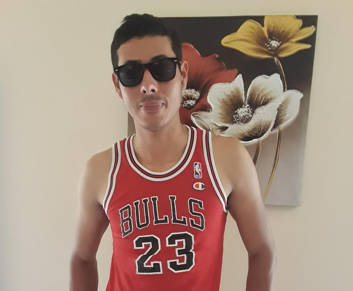 Alexis Levy poses proudly for the camera with his Bulls jersey and his shades on.