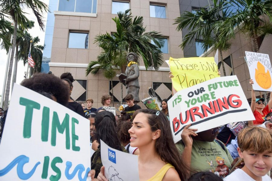 A large crowd of people protest Climate Change in front of the Broward County Public Schools District Offices in Fort Lauderdale, FL on September 20, 2019. Many creative posters were made by participants to convey their message through pictures and catchy phrases.