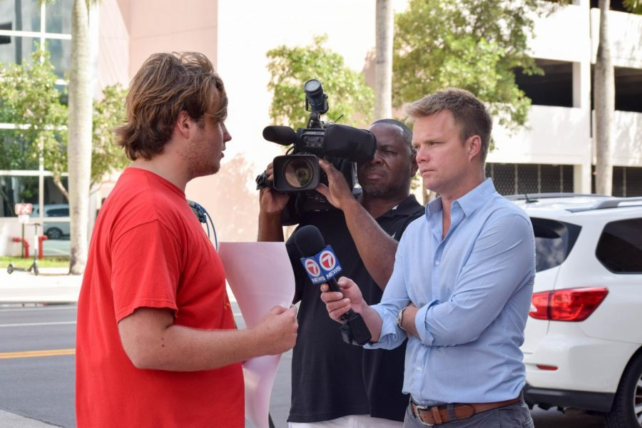 South Broward High School senior Elijah Ruby talks to Channel 7 News about the Global Youth Climate Strike and how he advertised the event at his school. Ruby along with other students who advertised the event at their school, including Nicole Buckley from Cypress Bay High, were being interviewed by Channel 7 News on their opinions and any repercussions they faced for participating.