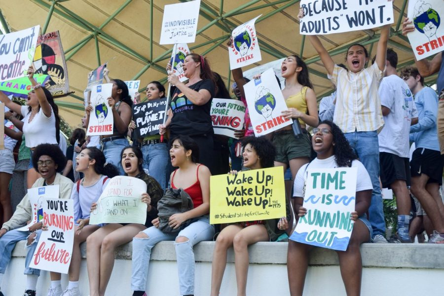 Students from public schools across Broward County protest Climate Change at an outside amphitheater in Fort Lauderdale, on September 20, 2019. The Global Youth Climate Strike started outside of the Broward County Public Schools District Offices, but eventually the protesters marched through the streets of Downtown Fort Lauderdale to a local outdoor amphitheater.
