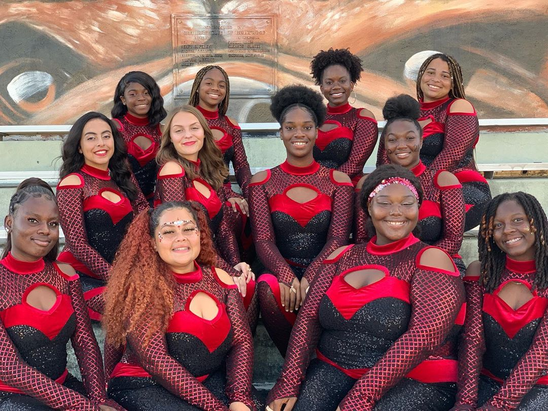 SBHS Color Guard team poses with their black and red sequin costumes.