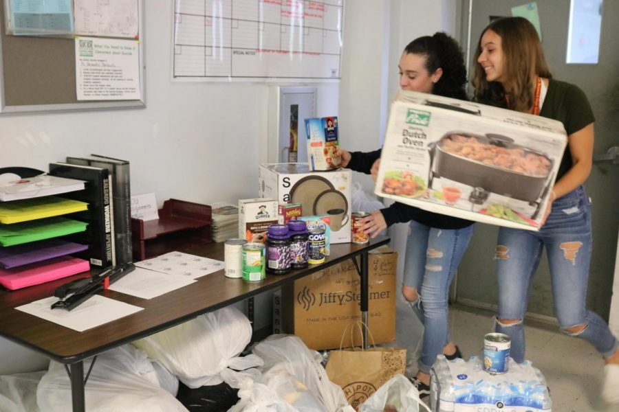 SBHS students Julia Sparkman and Nicole Conney donating for our harvest drive.