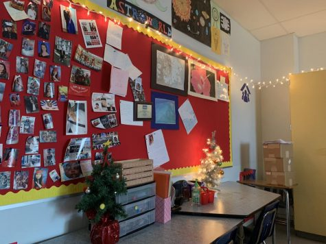 Holiday lights hang all around the classroom.