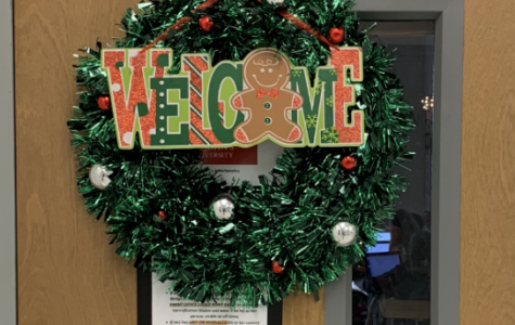 Ms.Cox's room entrance. A Christmas decorated reef.
