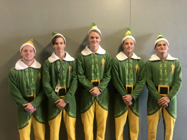 A group dressed up as elves.