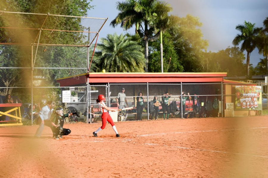 Anna Polanco swings at a fastball during the first girls softball game of the season on February 20, 2020. The team took on Flanagan High School for their first game.