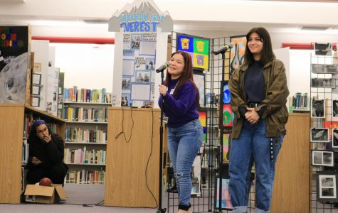 SBHS students Dahliah Rivas (left) and Bianca Preston (right) sing during lunch time at the media center for Art Week. Every year in the month of January, Art Week is full of presentations and performances, including drama and singing.
