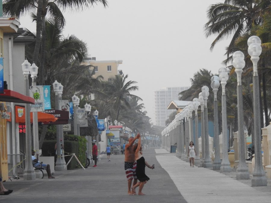 As this Coronavirus pandemic shuts everything down, old couple dance on the broadwalk of Hollywood beach. They normally spend their time at the beach even though its closed. They take advantage of the fact that the beach is empty.
