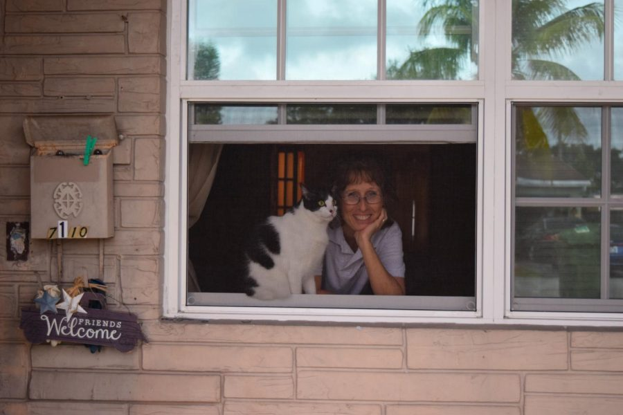 My grandmother Kathleen Moore and her cat Cookie look through her window. Before the virus, I would often visit my grandmother to pet her cats and make cookies, but the 6 feet rule has cut this down to saying hello through a screen window.
