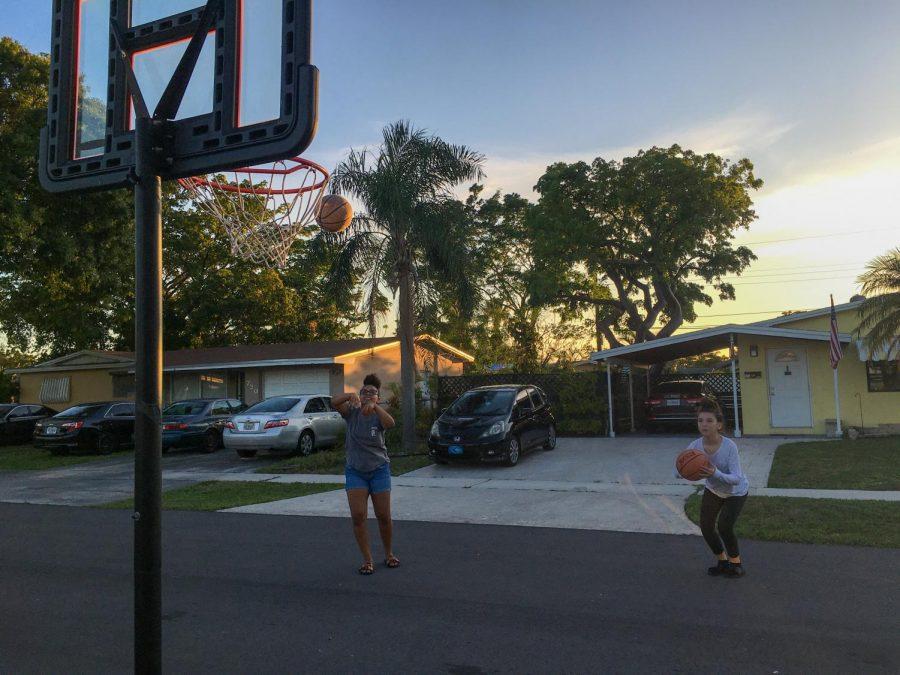 Julianna Ortega and her cousin Mya Moore stay 6 feet apart while playing basketball. Julianna, my younger sister, is often bored at home. So,  almost everyday, she calls our cousin to play a game of 6 feet apart basketball.