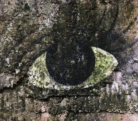 """The wall that stares back. Located deep in rural Colombia, near the border of Barbosa, Santander stands a short wall with an eye painted onto it. Painted by local mural artist """"Contrabo'' who passed away sometime in 1994."""