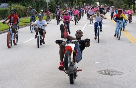 Marlon leading the pack in a mini dirt bike on the way to West Palm Beach Downtown.