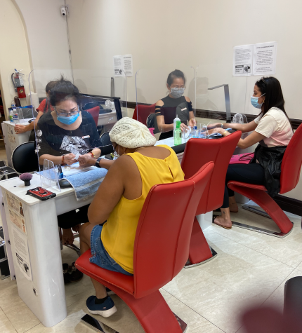 "This is a triple desk setup with 2 worker and clients with masks and a empty middle desk  For social distancing. They are also doing manicures with the shield and say the same as Ms.Campoverde.""to be honest work is still the same and i"
