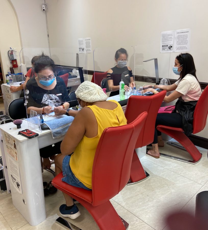 This is a triple desk setup with 2 worker and clients with masks and a empty middle desk  For social distancing. They are also doing manicures with the shield and say the same as Ms.Campoverde.