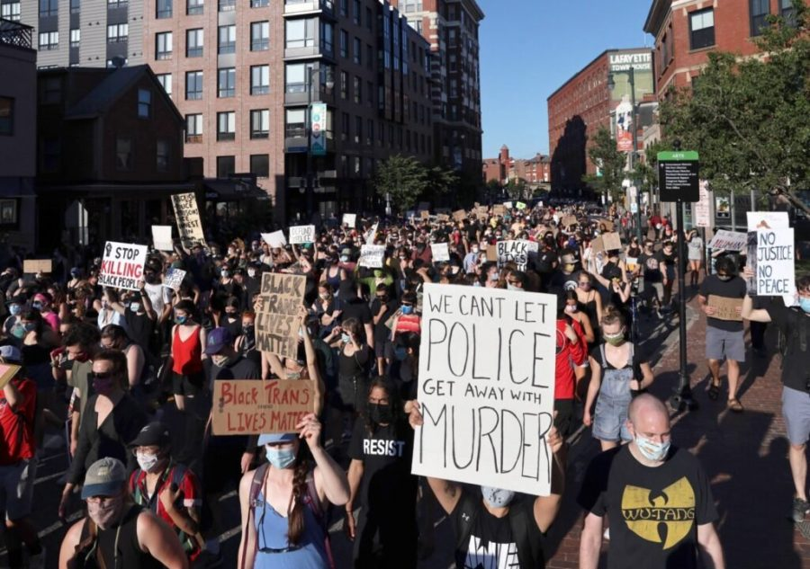 Protesters march on Congress Street located in Portland, Maine on June 19, 2020 which is also known as 'Juneteenth'.