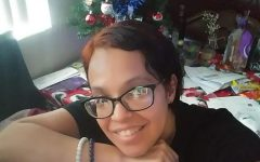 Lissette Reeve sitting in front of the family's Christmas tree