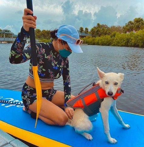 Heather G. and her dog Bella go out paddle boarding together.