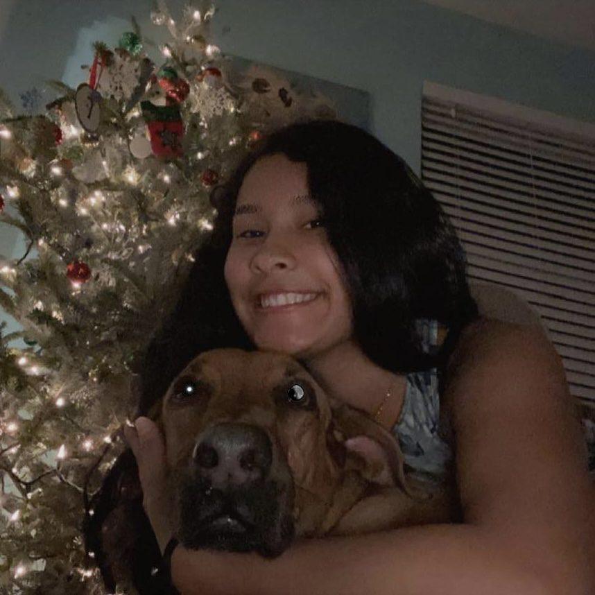 Fabiana celebrating Holidays with her dog.