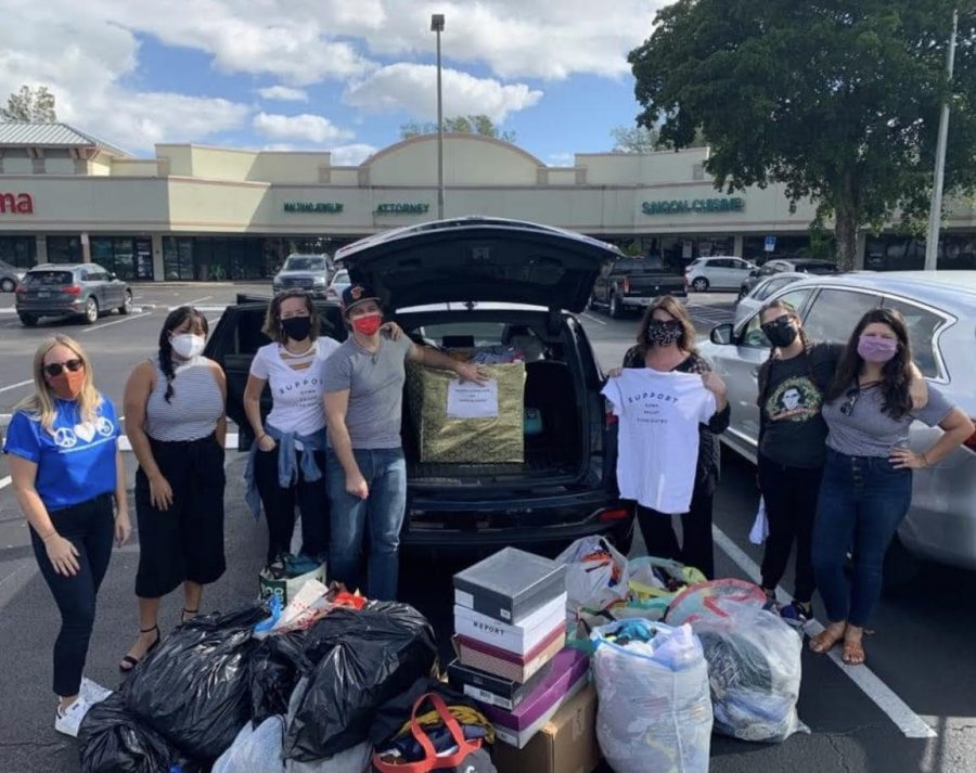 This+photo+was+taken+by+Ms.Hixon+as+the+volunteer%27s+show+the+donations+that+were+given+at+the+clothing+drive+for+the+Women+In+Distress+Thrift+Store.+