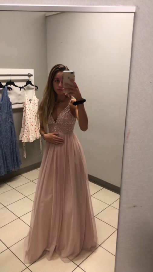 Isabel Gleeson, senior, is trying on the perfect dress for the perfect day
