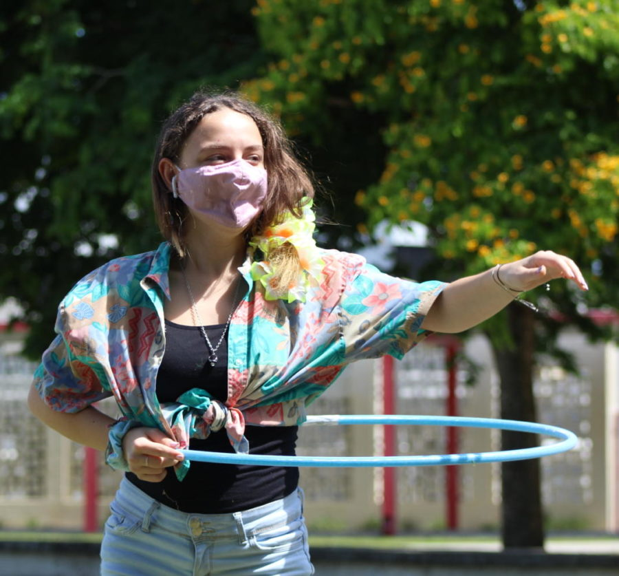 An art student whirls a hula-hoop around her waits during a hula hoop contest at a retirement party for their art teacher Mrs. Susan Ostheim. Ostheim had been teaching art at SBHS for almost 25 years.